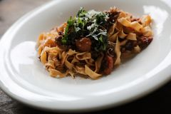 Pasta Fettuccine Bolognese with beef and tomato sauce. On a dish in close up stock photography