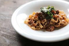 Pasta Fettuccine Bolognese with beef and tomato sauce. On a dish in close up stock images
