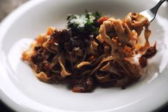 Pasta Fettuccine Bolognese with beef and tomato sauce. On a dish in close up stock photos