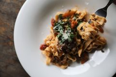 Pasta Fettuccine Bolognese with beef and tomato sauce. On a dish in close up royalty free stock image