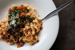 Pasta Fettuccine Bolognese with beef and tomato sauce. On a dish in close up stock image
