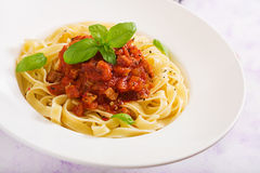 Pasta Fettuccine Bolognese with tomato sauce. In white bowl stock photo