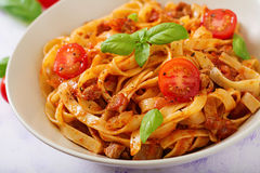Pasta Fettuccine Bolognese with tomato sauce. In white bowl stock image