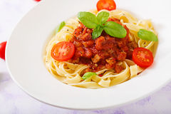 Pasta Fettuccine Bolognese with tomato sauce. In white bowl stock photos