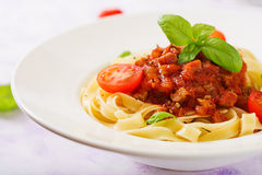 Pasta Fettuccine Bolognese with tomato sauce. In white bowl royalty free stock photography