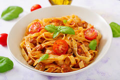 Pasta Fettuccine Bolognese with tomato sauce. In white bowl stock photography