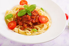 Pasta Fettuccine Bolognese with tomato sauce. In white bowl royalty free stock images