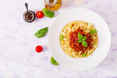 Pasta Fettuccine Bolognese with tomato sauce. In white bowl. Flat lay. Top view royalty free stock image