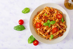 Pasta Fettuccine Bolognese with tomato sauce in white bowl. Flat lay. Top view royalty free stock images