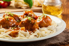 Pasta fettuccine and meatballs with tomato sauce Royalty Free Stock Photography