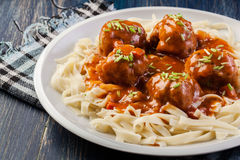 Pasta fettuccine and meatballs with tomato sauce Stock Photos