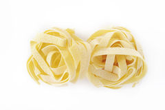 Pasta fettuccine nest Stock Photos