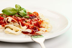 Pasta fettuccine with tomato sauce and basil Stock Images