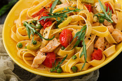 Pasta Fettuccine with tomato, zucchini and chicken fillet. In bowl Stock Images