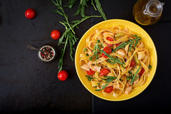 Pasta Fettuccine with tomato, zucchini and chicken fillet. In bowl. Flat lay. Top view royalty free stock photo