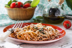 Pasta with fish and creamy spinach sauce Stock Image
