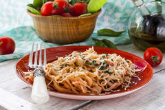 Pasta with fish and creamy spinach sauce Stock Images