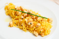 Pasta with fish and passionfruit sauce Stock Photography