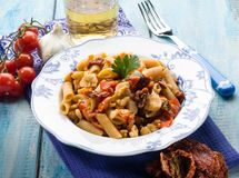 Pasta with fish ragout. And dried tomatoes Royalty Free Stock Photography