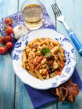 Pasta with fish ragout. And dried tomatoes Royalty Free Stock Photo