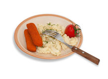 Pasta, fish sticks, cherry tomatoes and greens on plate with for Royalty Free Stock Photo