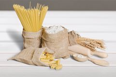 Pasta and flour. Italian egg wheat menu background closeup Stock Photography
