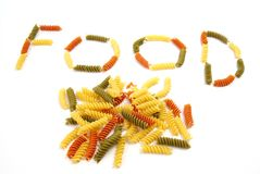 Pasta Food. Spiral pasta on white background creates the word FOOD Royalty Free Stock Image