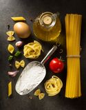 Pasta and food ingredient  on table. Pasta and food ingredient  on dark background Stock Photography