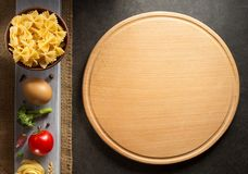 Pasta and food ingredient on table Royalty Free Stock Images