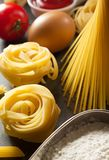 Pasta and food ingredient  on table. Pasta and food ingredient  on dark background Royalty Free Stock Photos