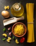 Pasta and food ingredient on table. Pasta and food ingredient on dark background royalty free stock photo
