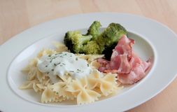 Pasta food. Pasta with parmesan cheese sauce, broccoli and roasted bacon. Pasta with cheese sauce, boiled broccoli and roasted bacon Royalty Free Stock Photography