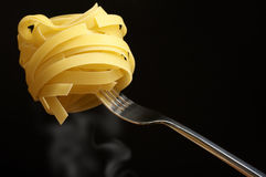 Pasta on fork Stock Photos