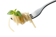 Pasta on a fork. With basil Stock Photo