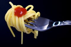 Pasta on fork. ON BLACK BACKGROUND Royalty Free Stock Photography