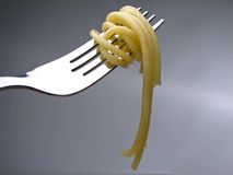 Pasta on fork. Pasta twisted around fork royalty free stock photography