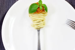 Pasta on fork with basil Royalty Free Stock Photography
