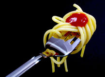Pasta on fork on black background Royalty Free Stock Photography