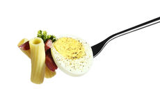 Pasta fork rigatoni with bacon egg pepper parsley and olive oil Royalty Free Stock Image