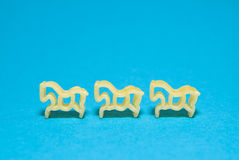 Pasta in the form of animals on a blue background Stock Photo