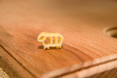 Pasta in the form of animals on a wooden surface Stock Photos
