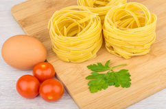 Pasta in form nest, egg. tomatoes cherry Royalty Free Stock Image