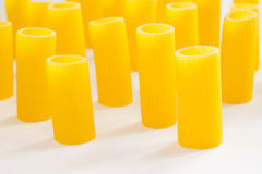 Pasta in the form of tubes closeup royalty free stock photos