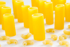 Pasta in the form of tubes and small horns royalty free stock image