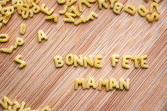 Pasta forming the text Bonne Fete Maman Royalty Free Stock Image