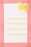 Pasta framed background. Pasta on white background and red checkered frame Royalty Free Stock Photo