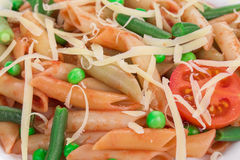 Pasta with french beans and parmesan. Stock Photos