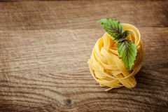 Pasta fresh basil on wood Royalty Free Stock Photos