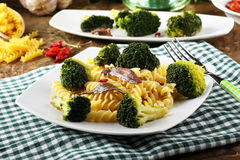 Pasta with fresh broccoli and anchovies. On complex background Royalty Free Stock Images