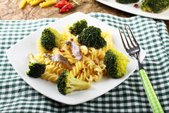 Pasta with fresh broccoli and anchovies. On complex background Royalty Free Stock Photo